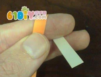 用手指弯曲纸条-幸运星折纸图解