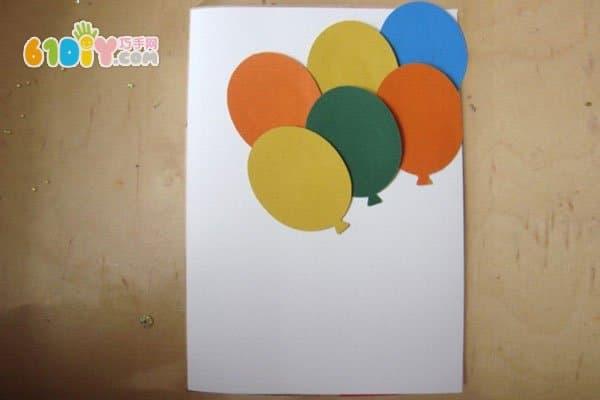 儿童制作新年气球贺卡